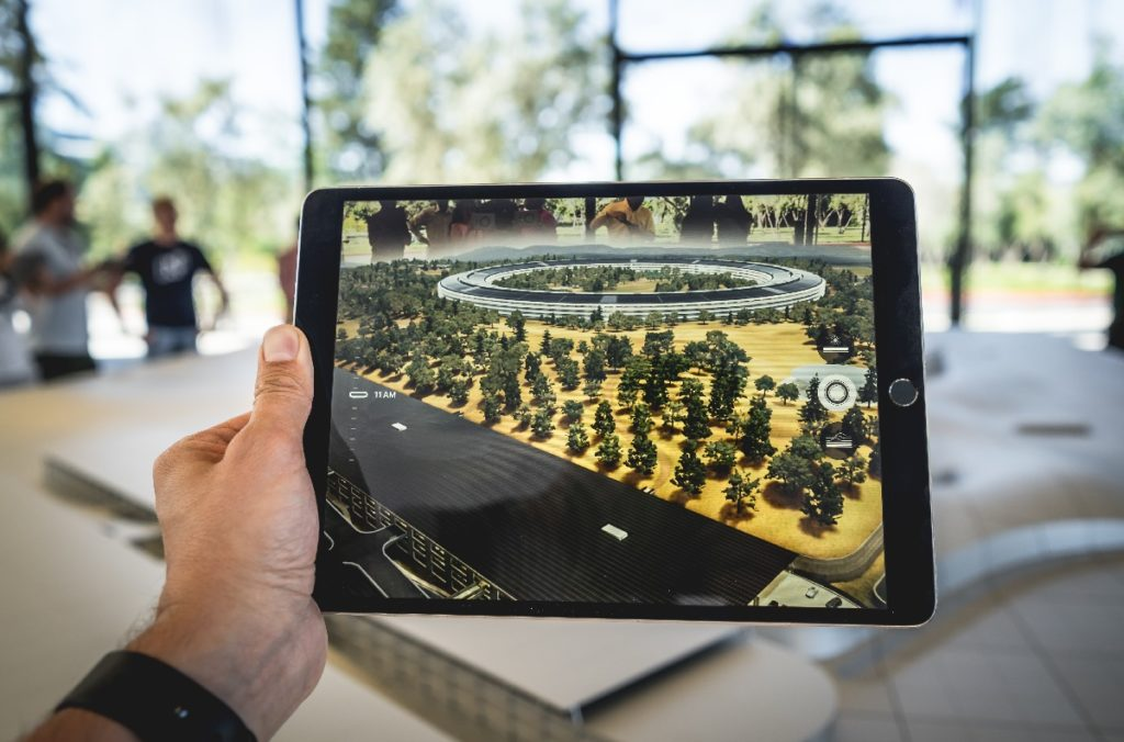Tablet showing AR view of architecture project